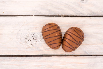 Chocolate eggs on a wooden table