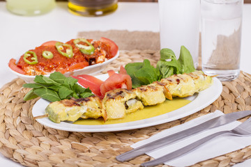 Whiting Fish Skewer on White Plate with Salad and Turkish Traditional Alcohol Drink Raki , Ouzo