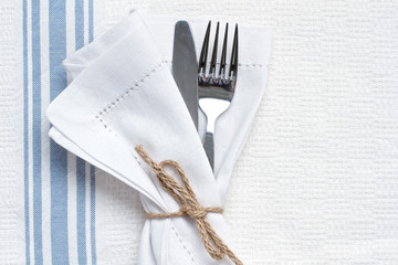 Knife and fork with blue and white linen