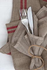 Knife and fork with linen