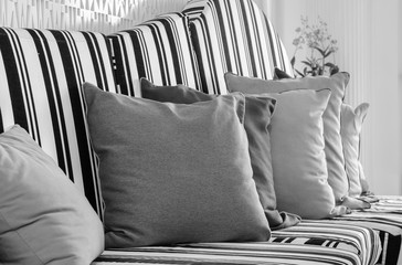 Pillows on sofa, close-up in black and white color tone
