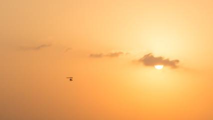 hang glider flying in the sunset over Dubai desert