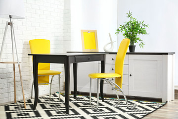 Modern room design. Furniture set with table and chairs.