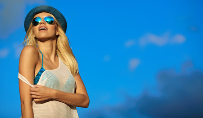 woman relaxing at the sky background . Summer hipster vacations