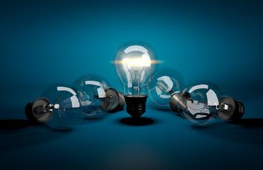 Concept of leadership. Glowing light bulb among dark ones lying