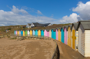 Bude Cornwall England uk colourful pastel beach huts on the beach