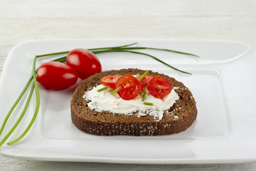 cream and vegetables on bread