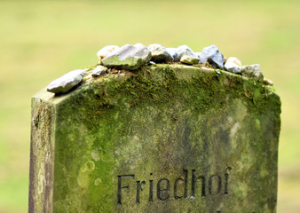 jewish cemetery, old graveyard. Old, mossy tombstone on a jewish cemetery.