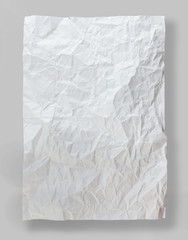 Full page of white paper folded and wrinkled isolated on gray background
