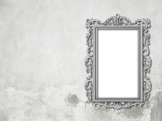 Close-up of one silver metal Baroque blank picture frame on grey concrete wall background