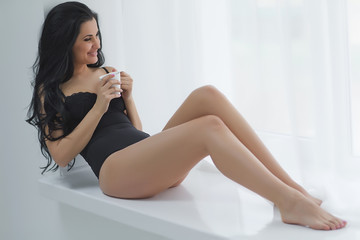 Sexy woman with cup of coffee
