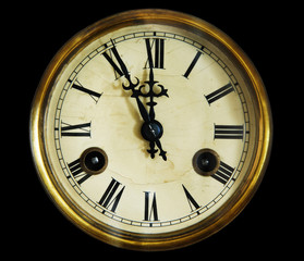 vintage clock face, isolated on a black background.