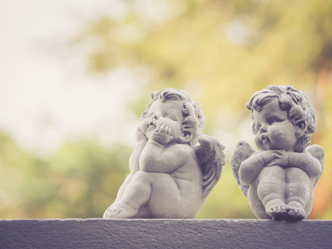 Baby doll sculptures; vintage filter