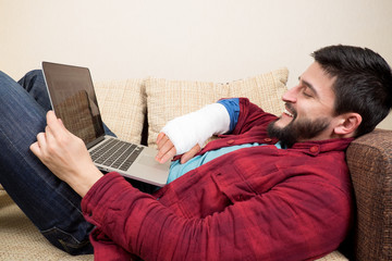 Working on laptop with injured hand
