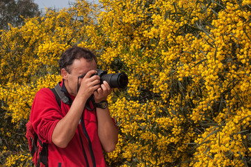 Nature photographer at work in a flowers