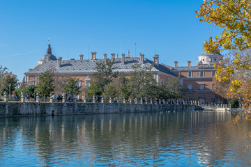 Palace of Aranjuez reflected in the water under a big blue sky