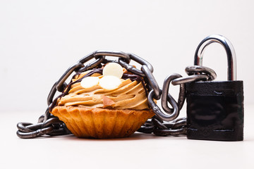 Cake with chain and padlock, diet concept.