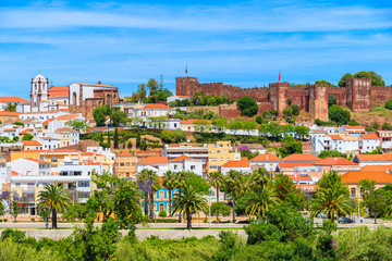 A view of Silves town buildings with famous castle and cathedral, Algarve region, Portugal