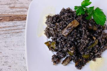 """Arroz negro"" spanish recipe, black paella with cuttlefish"