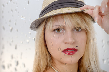 beautiful young pretty blonde woman with summer hat
