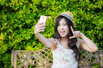 asia woman use smartphone take photo