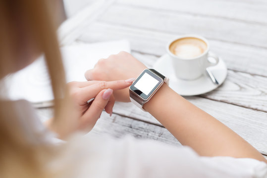 Female setting up her new smart watch.