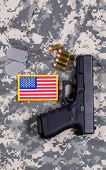 USA Flag patch on military uniform with weapon and ammo