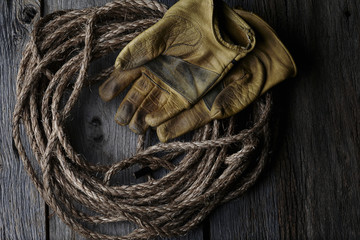 Cowboy rope and leather gloves