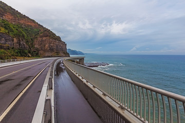 View of the magestic Sea Cliff Bridge and surrounding landscape of Grand Pacific Drive, Sydney, Australia.