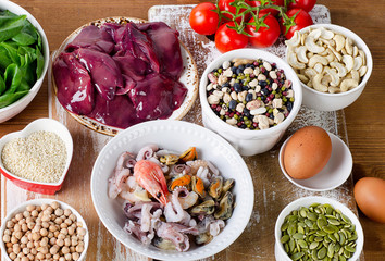 Foods high in Iron, including eggs, nuts, spinach, beans, seafoo