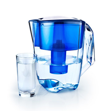 Water filter and a glass of purified water isolated on white bac