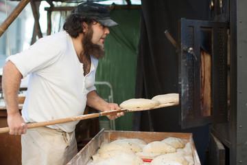 Wall Mural - Man bakes bread