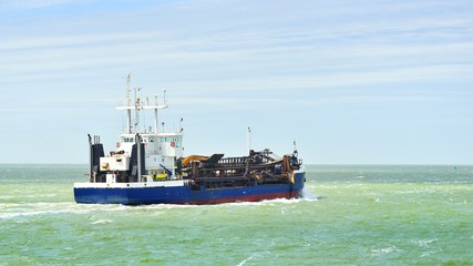 Blue cargo ship (tanker) is sailing near Vlissingen, the Netherl
