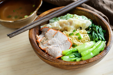 Egg chinese noodles with roast pork and dumpling