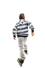 Back view young boy on rollers. Rear view. Isolated on white background