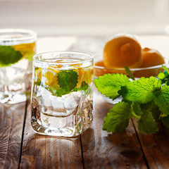 Lemonade with fresh lemon  with sugar and mint on wooden backgro