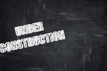 Chalkboard writing: Under construction sign