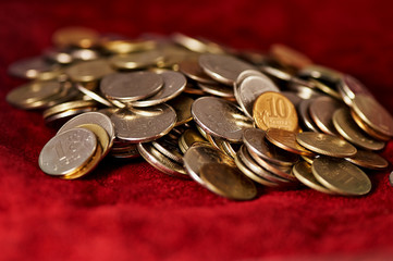A lot of Russian coins on a background of red suede