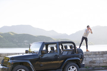 Young man and jeep