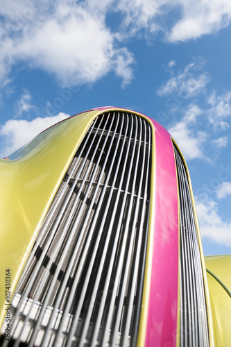 Wall mural retro vehicle grille against sky