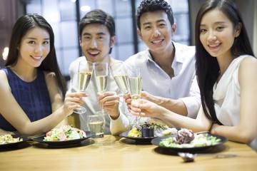 Friends having dinner together