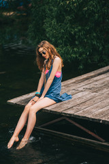 hippie girl on the dock