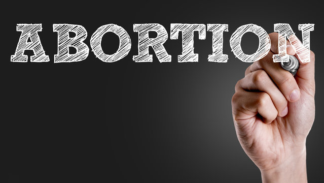 Hand writing the text: Abortion
