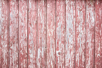Red peeling paint. Wooden desk grunge background.