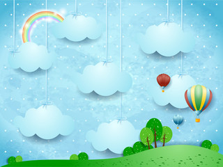 Printed kitchen splashbacks Light blue Surreal landscape with hanging clouds and hot air balloons