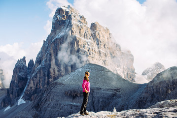 Girl tourist admires the peaks in the Alps