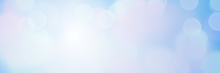 sunlit soft bokeh banner background in shades of blue