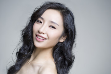 Headshot of young beautiful woman