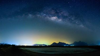 Wall Mural - Panorama milky way galaxy over mountain, Thailand.