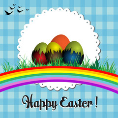 Abstract colorful background with rainbow, grass and Easter eggs. Easter postcard concept